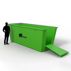 customer standing next to large 8m skip bin he has hired for the weekend to remove waste from his home and have it taken to the recycling plant in Brisbane