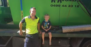Rory Crundall owner of Jumbo Skip Bins loading bin with waste for transport to dump in Brisbane